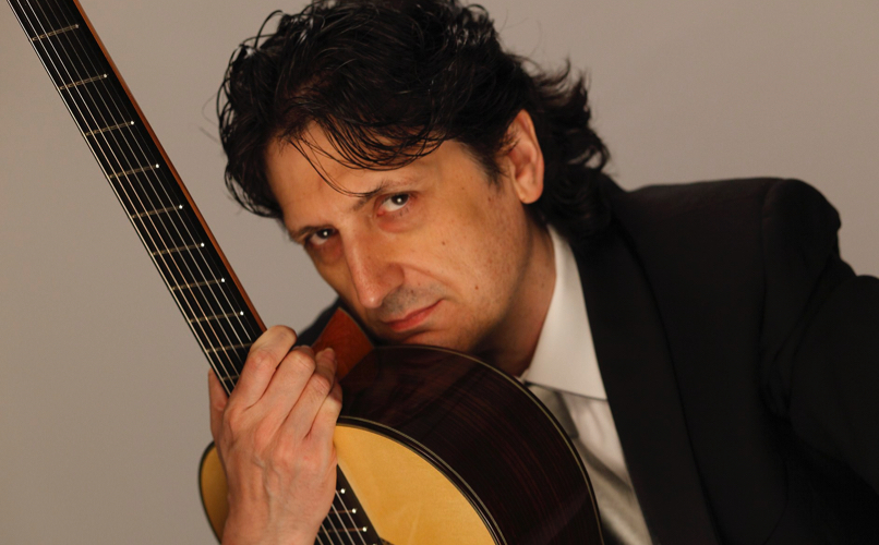 Portrait of guitarist Juan Cañizares with his guitar