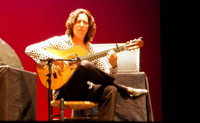flamenco guitar player on stage performing