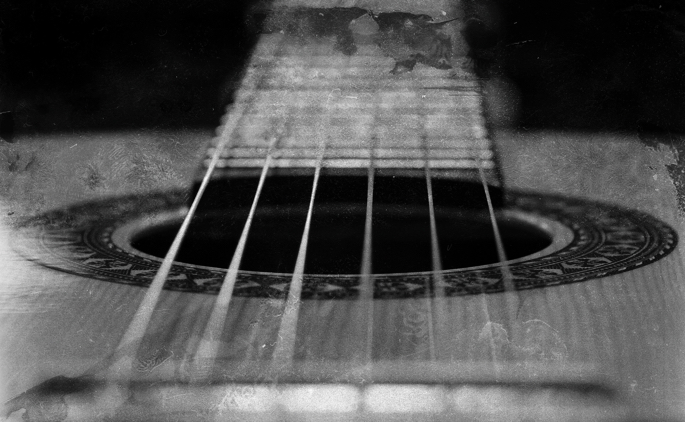 Extreme close up image of a flamenco guitar, looking from bridge to neck.