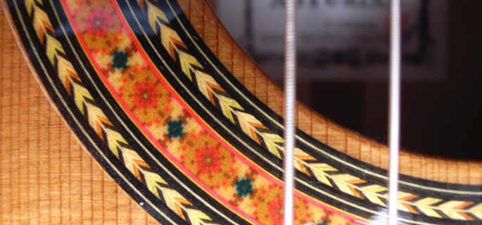 Close up image of a flamenco guitar rosette.