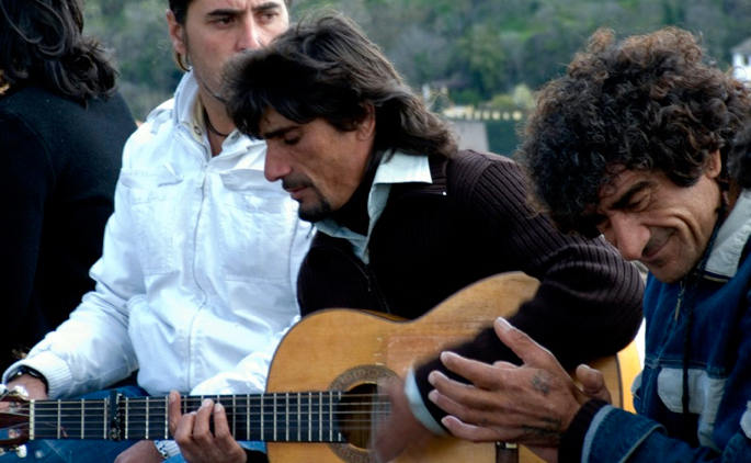 Flamenco guitarist and palmero performing informally outside